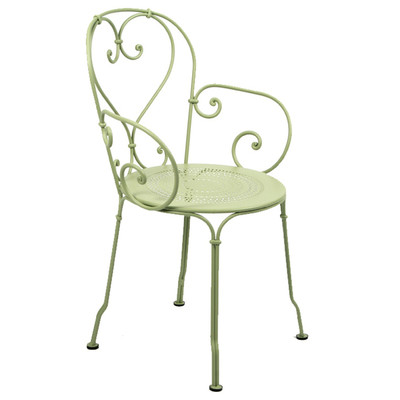 The 1900 stacking armchair shown in Willow Green.