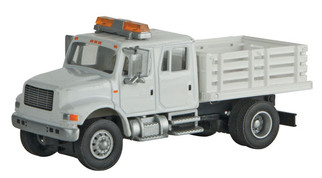 949-11894 HO Scale Walthers SceneMaster International 4900 Open Stake Bed Utility Truck-White w/Railroad Decal