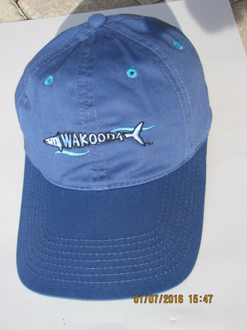 Blue Cap with extra long visor made out of 100% cotton.  Vents in turquise on the top keep you cool in summer and the Walooda is laced across the front of the cap.