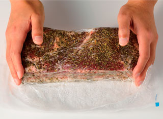 2. Wrap the sheet tightly around the food.