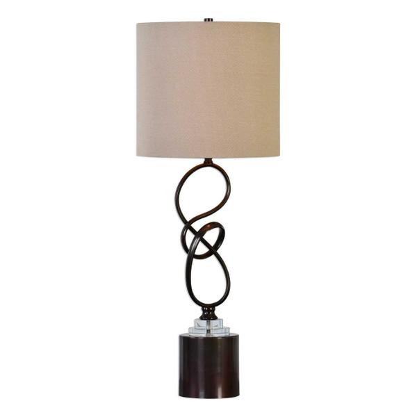 Hand molded twisted steel finished in plated dark bronze featuring crystal steps over a tall cylinder foot. The round hardback drum shade is an off white linen fabric.