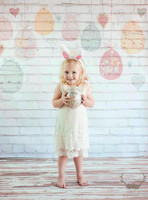 Hanging Easter Eggs On White Brick Backdrop