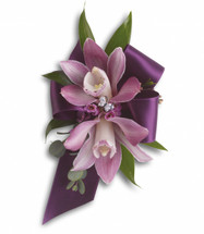 "Purple miniature cymbidium orchids, lavender waxflower, Italian ruscus and parvifolia eucalyptus. Approximately 4 1/4"" W x 7"" H"