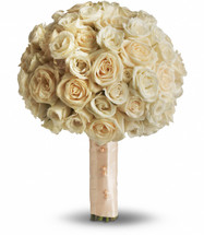 "A generous bouquet of crème roses bound with a satin ribbon. Approximately 10"" W x 13"" H"