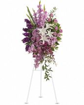 Blessed, peaceful rest is expressed in this cascading purple spray accented with white lilies. Such graceful grandeur would honor a memorial service. Peaceful blooms such as lavender roses, gladioli and hydrangea, with purple orchids and white oriental lilies. Orientation: One-Sided