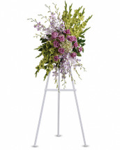 Express your heartfelt sentiments with this breathtaking funeral spray, so evocative of heavenly angels. These green and lavender flowers of hydrangea, orchids, roses and gladioli feel light and feminine. Presented as a standing easel display. Includes stunning flowers such as green hydrangea and gladioli, lavender orchids and roses. Orientation: One-Sided