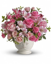 Send your condolences on the loss of a lovely lady with this feminine bouquet of light pink sympathy flowers. The pretty pink arrangement is a heartfelt choice. A feminine mix of pink roses, pink alstroemeria and green pitta negra are presented in a charming French Country Pot. Orientation: All-Around