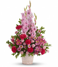 Beautifully feminine. Serene but strong. This pretty basket of pink flowers is a lovely way to show you care.