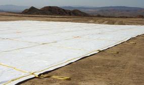 6.6 oz. 14 mil White/Black Polyethylene Landfill Covers