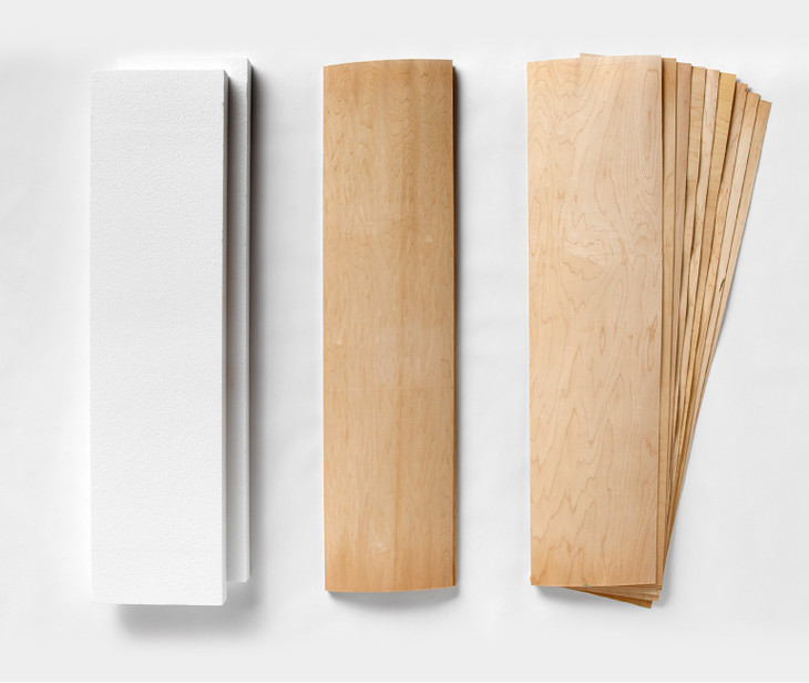 """Two 9-layer sets of maple longboard 12 x 47"""" veneer, and two slabs of foam for shaping"""