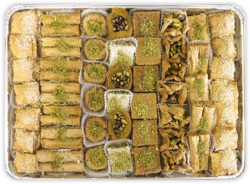 Assorted Baklava pieces arranged on a rectangular tray - Top view - Libanais Sweets