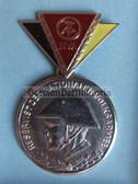 om965 - 3 - East German NVA  Reservist Medal in Silver with Steel Helmet