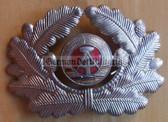 sbbs058 - c1960's two piece enamel NVA Army and Grenztruppen officer Visor Hat insignia - visor cockade