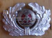 sbbs057 - c1960's two piece enamel NVA Army and Grenztruppen EM non-officer Visor Hat insignia - visor cockade