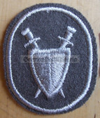om093 - NVA Army Military Justice Troops qualification sleeve patch - for Fähnrich ranks only with white border