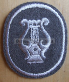 om098 - NVA Army Military Musician qualification sleeve patch - for Fähnrich ranks only with white border