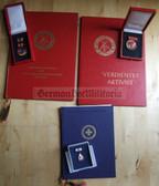 ag052 - award grouping including Verdienter Aktivist - Verdienstmedaille der DDR - Red Cross Ehrenspange