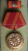 om923 - 3 - VOLKSPOLIZEI VP - LONG SERVICE MEDAL IN GOLD FOR 30 years service - East German Police Service