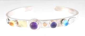 A PROTECT THIS WOMAN BRACELET, AMETHYST