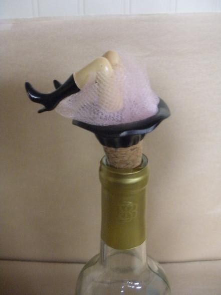 Wine bottle topper. Legs jiggle.