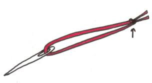Threaded needle with red string