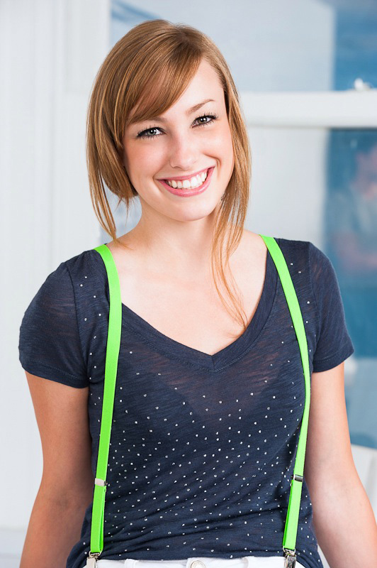 Model wearing bright green suspenders