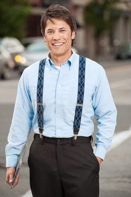Model wearing blue plaid suspenders outside