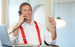 Model wearing red suspenders talking on the phone