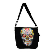Multi colored Day of the Dead skull on black messenger bag.