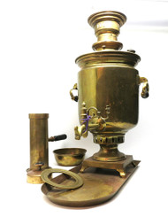 An early to mid-20th century brass samovar set marked Germany with tray, bowl, chimney, cap, teapot ring