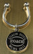 Coach keychain.  Made of non tarnish high quality nickel plate.  Beautifully engraved round disk with coach logo and text arched across the top and bottom.  Makes a great gift for coach.  Comes with horseshoe shaped keyring, round split ring keyring, engraved disk and comes boxed in a silver cotton filled gift box.