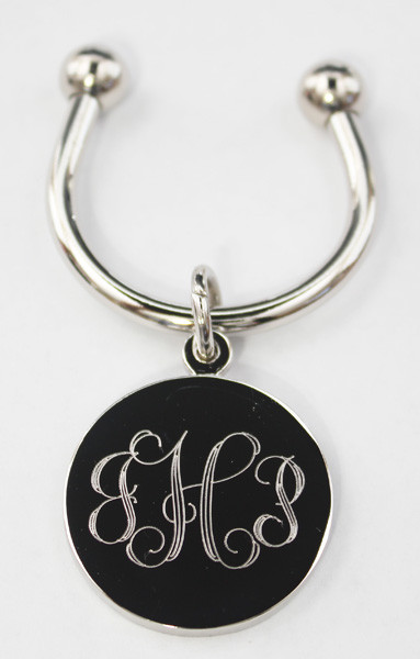 Monogram Keychain.  Comes with three monogram initials on the front, and the back can be engraved up to four lines of text on the back for an extra $3.00.