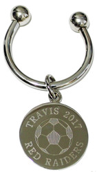 Soccer keychain.  Made of non tarnish high quality nickel plate.  Beautifully engraved round disk with soccer ball graphic and text arched across the top and bottom.  Makes a great gift for players and coach.  Comes with horseshoe shaped keyring, round split ring keyring, engraved disk and boxed in a silver cotton filled gift box.
