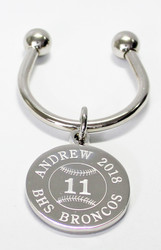 Baseball keychain.  Made of non tarnish high quality nickel plate.  Beautifully engraved round disk with baseball graphic with their number engraved in the center, and text arched across the top and bottom.  Makes a great gift for baseball players and coach.  Comes with horseshoe shaped keyring, round split ring keyring, engraved disk and comes boxed in a silver cotton filled gift box.