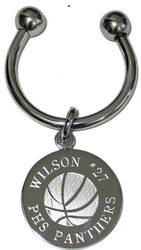 Basketball keychain.  Made of non tarnish high quality nickel plate.  Beautifully engraved round disk with basketball graphic and text arched across the top and bottom.  Makes a great gift for basketball players and coach.  Comes with horseshoe shaped keyring, round split ring keyring, engraved disk and comes boxed in a silver cotton filled gift box.