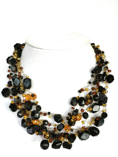 """#AN51 Hand crocheted on fine gold wire, multi strand assorted black beads with faceted amber colored Czech crystal accents  Price: $155.  Length 18"""" long, may be  custom ordered in other sizes for added charge"""