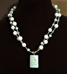 """#AN66 Necklace Large Turquoise Stone Pendant with Two Strands of Complimentary minty green and turquoise Beads with tiny aquamarine colored crystal seed beads in between  Price $75.  Length 19"""" Available in custom size to fit your needs for a slight extra charge Earrings are available upon request. $25. in wire, post or clip on"""