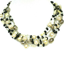 Necklace Multi Strands of onyx chips, tiny Crystal Beads, Pearls and Silver Hand Crocheted to make an Elegant Statement