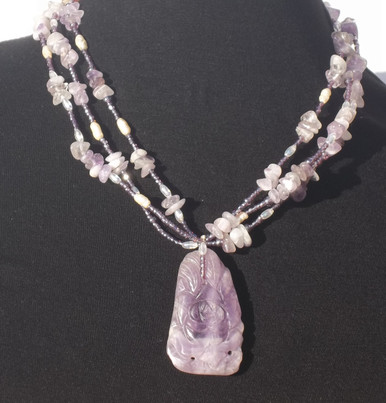 "#AN53 Fabulous Carved Amethyst Pendant with Multi Strands of Amethyst Chips, Pearls and tiny Glass Beads as accents. Price $165.  Length  including pendant 19 1/2 "" but may be custom ordered in prefered size for additional charge."