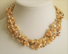 "#AN19 Multi Strands of  Semi Precious Coral Chips and Coral Colored Pearls and crystal all Hand Croched  together to make a lovely choker .  Price $150.   18"" long but may be special ordered in preferred size for an additional charge."