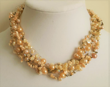 """#AN19 Multi Strands of  Semi Precious Coral Chips and Coral Colored Pearls and crystal all Hand Croched  together to make a lovely choker .  Price $150.   18"""" long but may be special ordered in preferred size for an additional charge."""