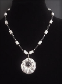 """# AN52   Necklace with a Silver Pendant with Onyx Stone, hanging from a  single strand of  Varied shapes of Black and Silver accents $85..  18 1/2"""" or may be ordered in custom size for extra charge."""