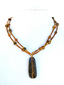 #AN87 Beautiful  and Delicate Necklace made with Carved Semi-Precious Tiger Eye with Double Strand of Tiger Eye and Glass Beads. Wear it with pride or give it as a gift to someone special  Price: $55. Length 18""