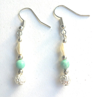A85 Silver Flower Bead, Turquoise, pearl  $25. May be ordered in wire, post or clip