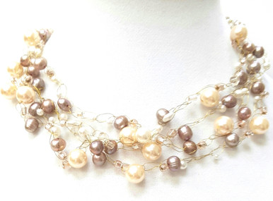 """#BN70 Neutral and  Delicate Taupe and Cream Colored Pearls Hand Crocheted onto Multiple Strands of fine Gold Wire   This necklace will add style and sophistication to any outfit and will be a staple in your wardrobe. Price $165.  18"""" long  Available in custom size to fit your needs for a slight extra charge"""