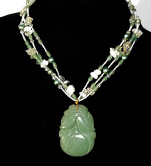 """#AN41  Beautiful Carved Green Jade Pendant on Three Strands of Jade, Aquamarine, Pearls and tiny Crystals 18"""" $175. Available in custom size to fit your needs for an extra charge"""