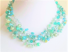 #AN70 Lightweight and Airy Designer hand made  Necklace of multiple strands of assorted Aqua beads and pearls tr hand crocheted onto fine wire to create a delicate, simple feminine statement  Price: $155.  16' or 17' long. However, if you prefer another size I can make it on special order for a small  extra price.