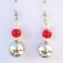 #B20 Using Bright Silver and Vivid Red Lois Becker has hand-made wonderful earrings that will be a great accessory for your wardrobe Price $25. Available in Post, Wire or Clip on