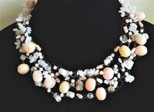 """#AN79 Designer Necklace, handmade Delicate choker , multiple crocheted  strands of  Pale Pink Lacquer beads , pink pearls, crystals and airy frosted white beads , very feminine statement Price:$155, length 18"""" But may be special ordered in your prefered size for an additional charge."""