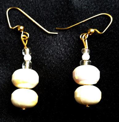 #B25  Lightweight Earrings handmade with Pearlized White Lacquer Beads with a tiny Glass Accent to give it added glamor  $25. Available in post, wire or clip on